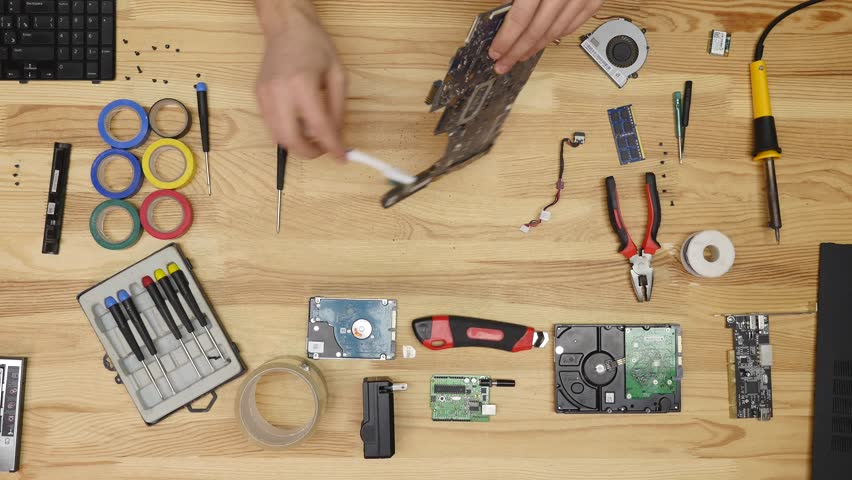 Male engineer repairs laptop. Wooden table top view. | Shutterstock HD Video #25062974