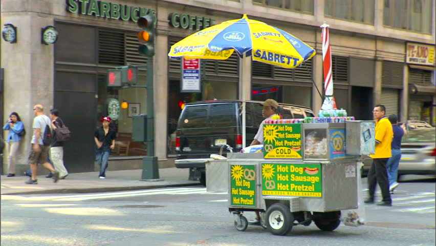 New York, NY - CIRCA 2006: A street vendor drives his cart down the street at the end of his shift