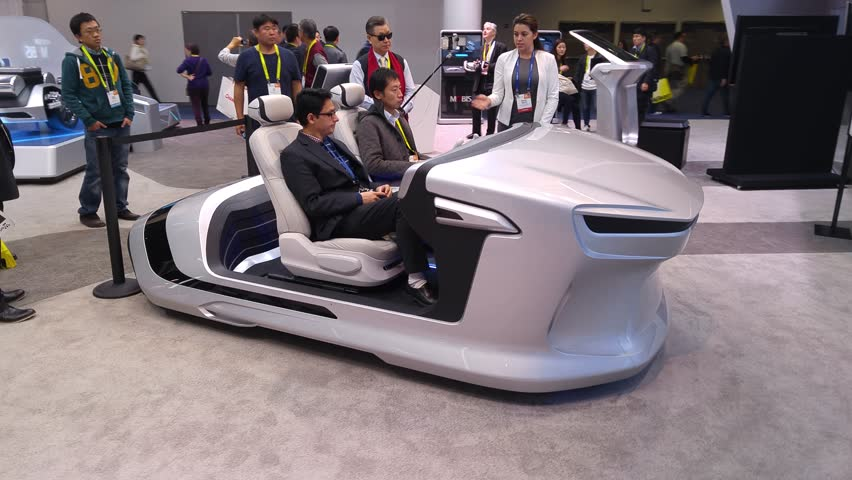 LAS VEGAS - January 08, 2017: People experiencing Hyundai Mobis autonomous self-driving concept car system presentation at Hyundai booth at CES 2017 consumer electronics trade show. 4K UHD