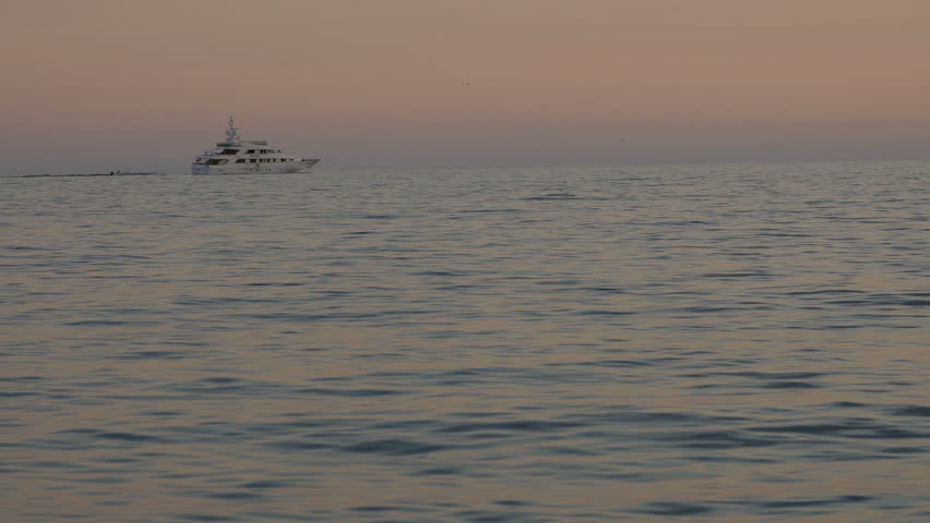 Luxury yacht navigating in mediterranean sea in the evening. Calm water swell. | Shutterstock HD Video #25097591