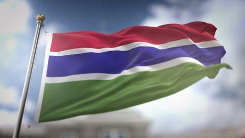 The Gambia Flag Waving Slow Motion 3D Rendering Blue Sky Background - Seamless Loop 4K