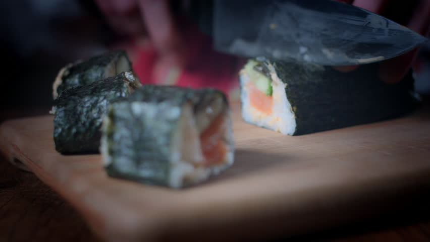 4K Traditional Chef Cutting Fresh Sushi Rolls | Shutterstock HD Video #25112171