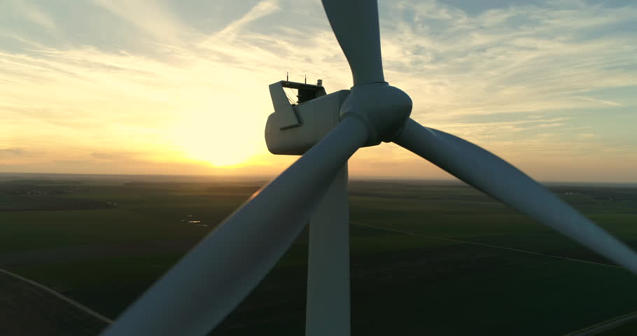 Wind Turbines over a sunset background. loop. Alternative renewable energy production in France, 4K, UHD (3840X2160)