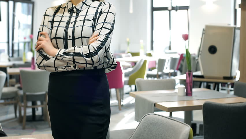 Elegant businesswoman in checked shirt and pencil skirt looks irritated, steadycam shot  | Shutterstock HD Video #25125014