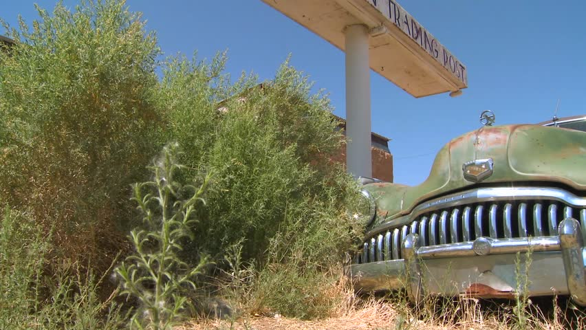 BLUFF, UTAH - CIRCA 2010 - An old car rusts at the abandoned Cow Canyon Trading Post outside Bluff, Utah.