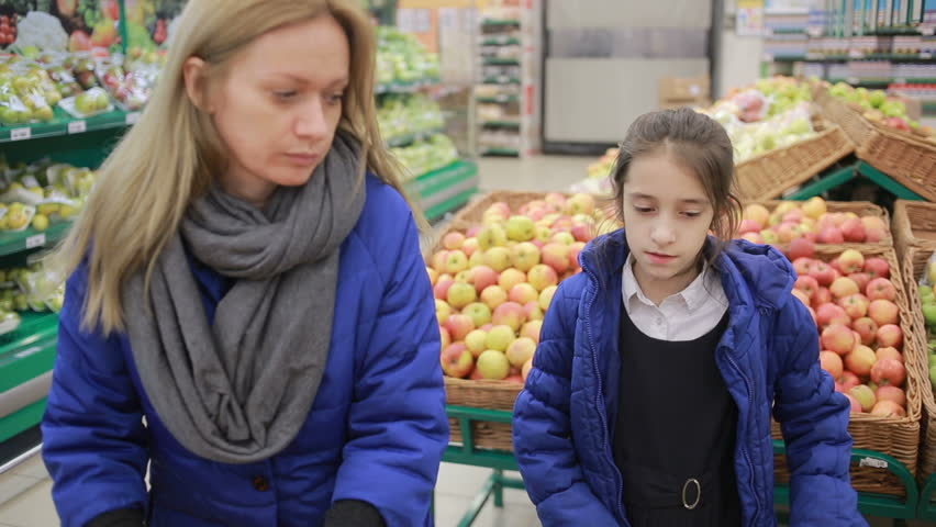 The daughter and her mother are shopping at the supermarket. Little assistant mistress | Shutterstock HD Video #25167155
