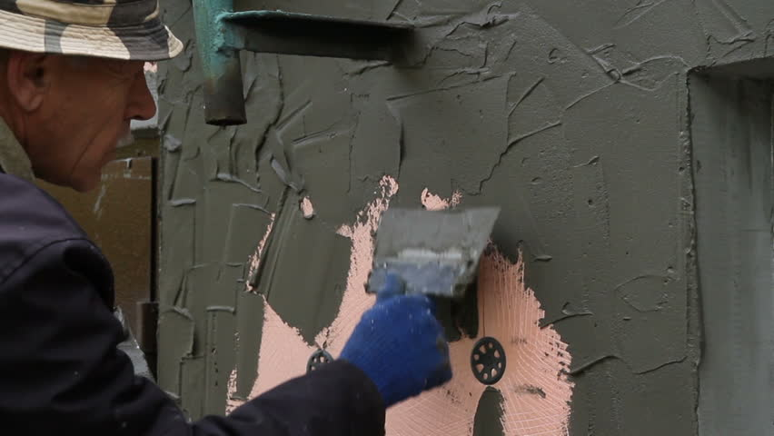 Worker plastering the facade of the building, close-up | Shutterstock HD Video #25182371
