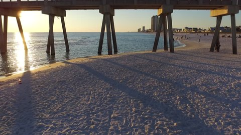 Sunset over the Gulf of Mexico, Drone flying under pier.