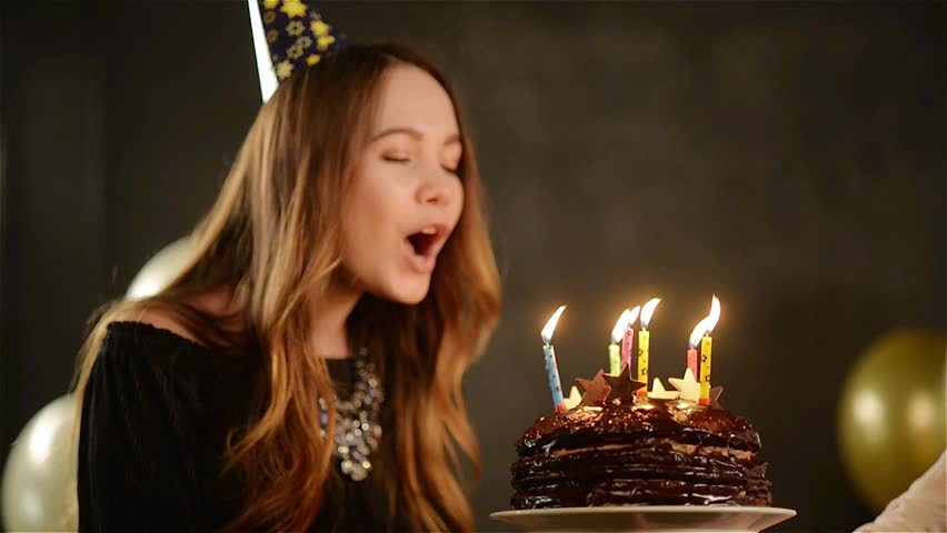 Happy Emotional Girl Blows Out Candles During Celebration Her Birthday And Applauds Close Up Portrait Of Young Lady With Chocolate Cake