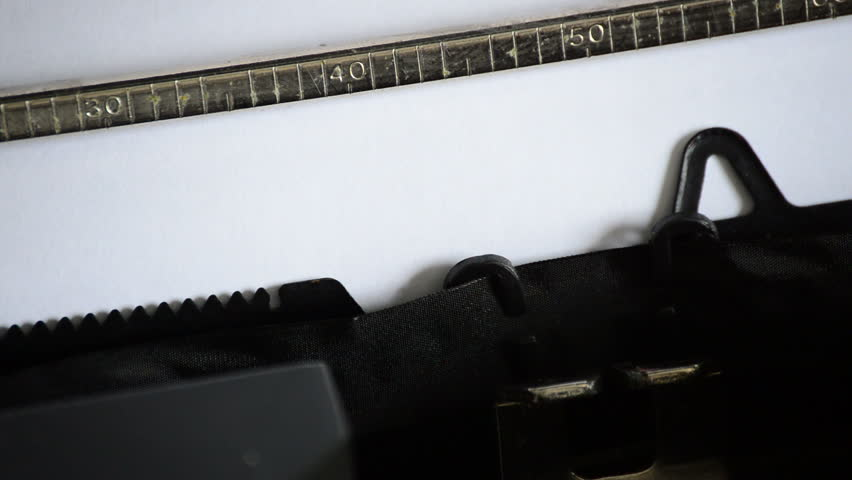 Typing the expression GUILTY with an old manual typewriter