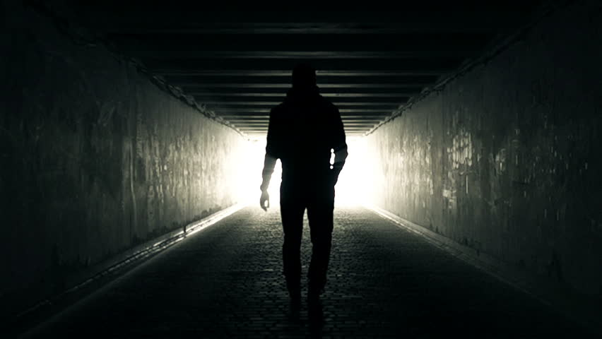 Slow Motion Video of Man walking in Tunnel to the Light