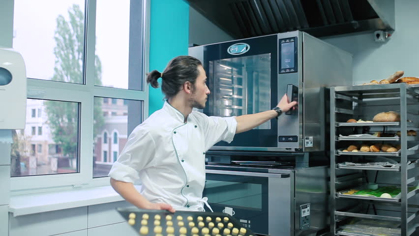 Confectioner opens the oven. | Shutterstock HD Video #25325111