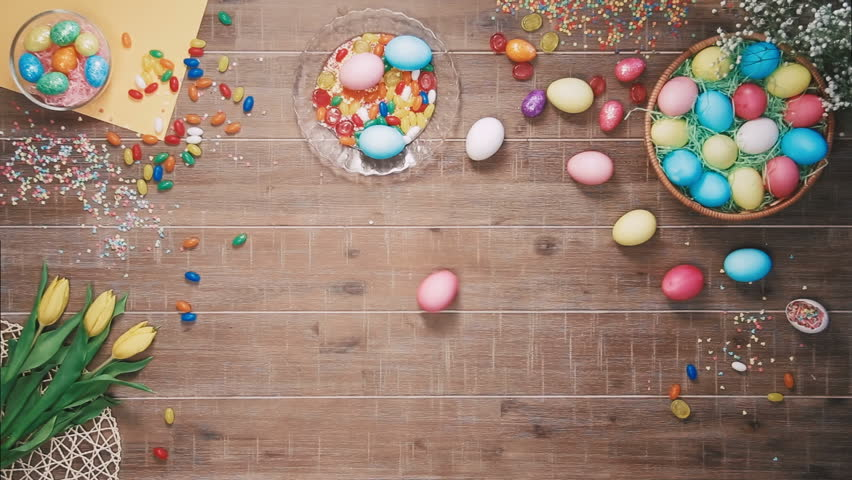 Easter egg spins on table decorated with easter eggs. Top view   Shutterstock HD Video #25343021