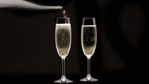 Loopable Cinemagraph Video. Pouring Champagne into flute glass.