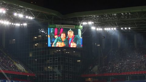 MOSCOW, RUSSIA - SEPTEMBER 10, 2016: People kissing on camera on screen at stadium CSKA during the match CSKA - Terek. Inscription - for the Champions