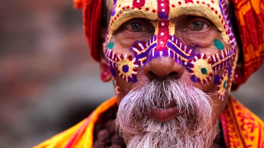 Portrait of sadhu (religious ascetic or holy person) who looks into the camera in the Pashupatinath temple complex that is on UNESCO World Heritage Sites's list Since 1979. Kathmandu, Nepal.
