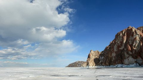 4K. Movement of the clouds over the icy Lake Baikal on Olkhon Island, Irkutsk region, Russia. Ultra HD, 4096x2304.