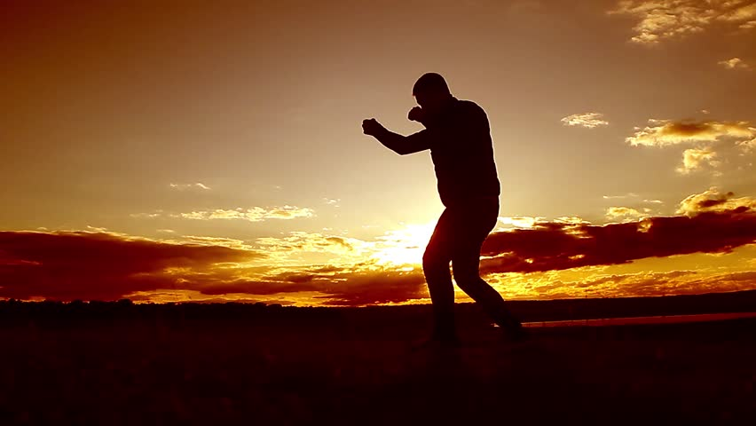 Silhouette of man boxing with shadow on the beatch at sunset intentional sun flare and vintage color. Man Engaged In Melee Combat Sports Boxing At Sport Sunset Shadow Boxing | Shutterstock HD Video #25390730