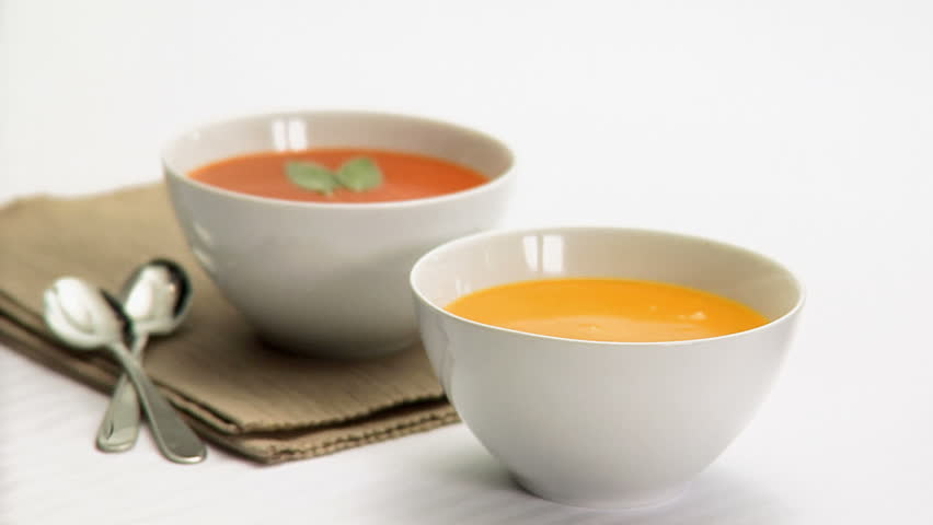 Ladling soup into bowl