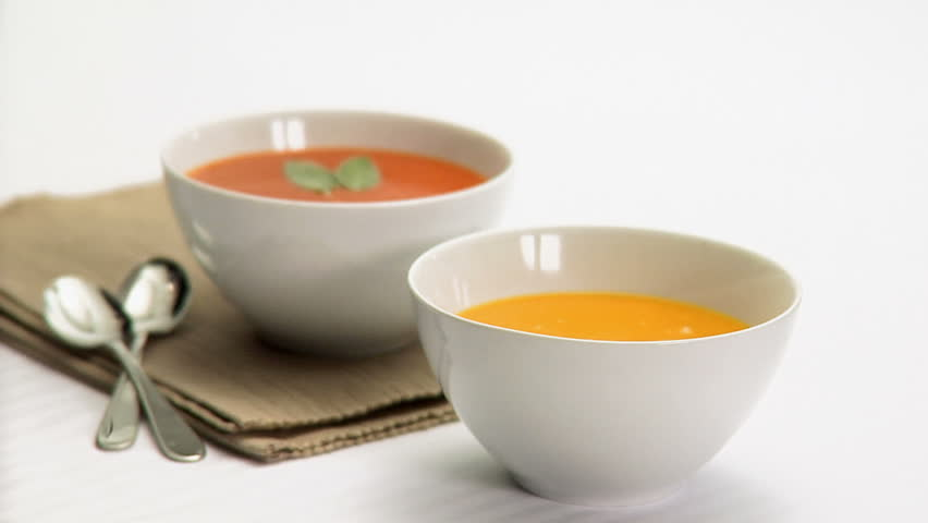 Pouring soup from pan into bowl