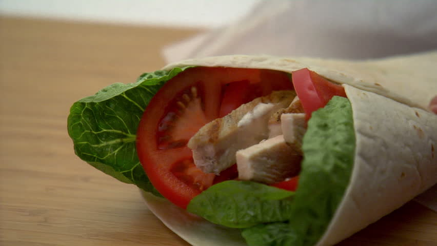 lock down of chicken wrap being wrapped in paper