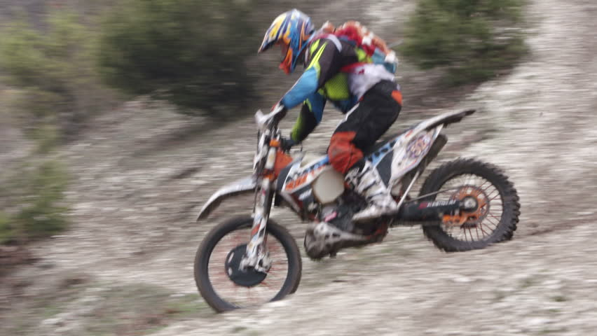 Man Jumps Motorcycle On Sand Dunes Slow Motion Stock Footage