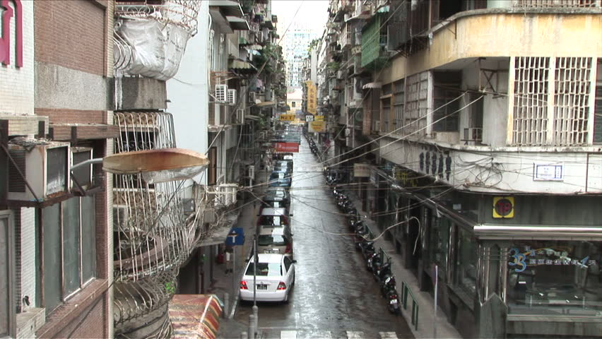 Macau China Circa March 2007 Very Narrow Street Full Of Apartment Buildings With Almost Ody On The Road