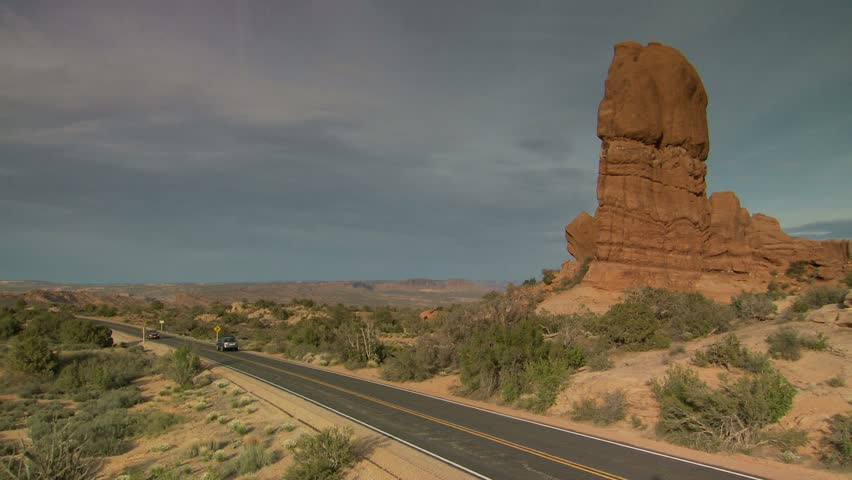 Cars Driving On Desert Road In Arches National Park