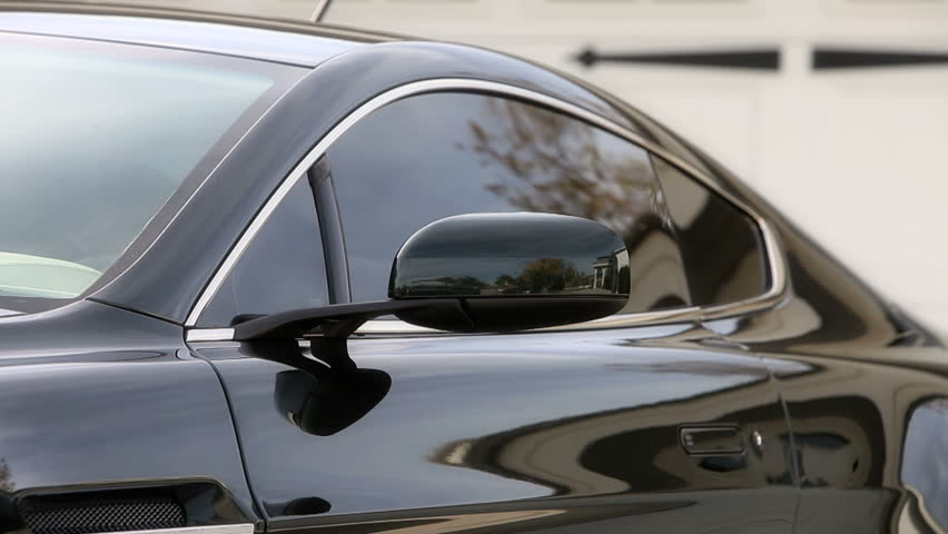 Man getting into car on drivers side | Shutterstock HD Video #2545853