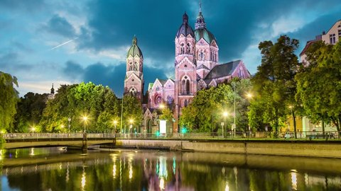 St. Luke Church, is the largest Protestant church in Munich, Germany (static image with animated sky and water)