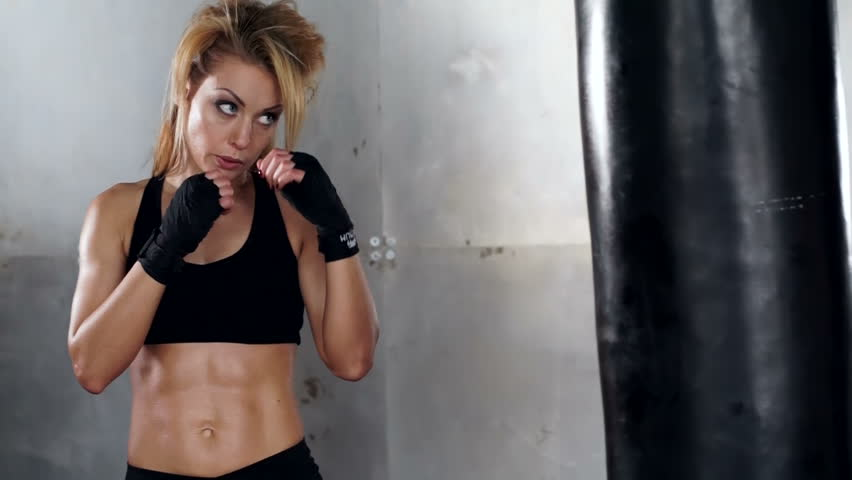 A beautiful and fit woman has a kickboxing training. Sport, health, concept. | Shutterstock HD Video #25485581