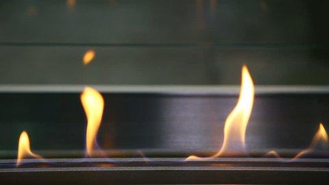 Burning bio fireplace. Close up flame shooting.