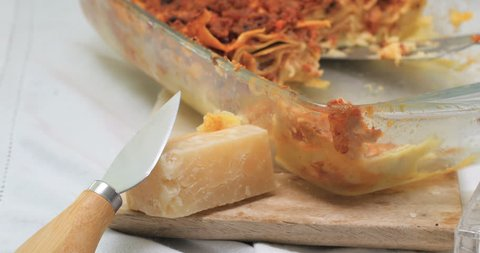 Dolly view of delicious steamy lasagne in bolognese sauce
