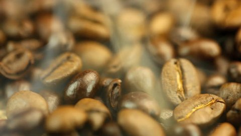 Brown Coffee beans with steam loop video HD