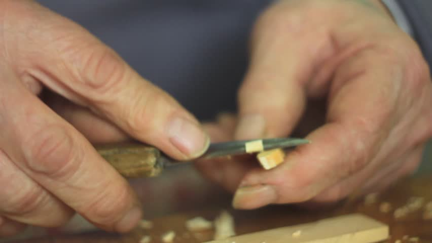 Artisan woodcarver creates a ornament. | Shutterstock HD Video #25562051