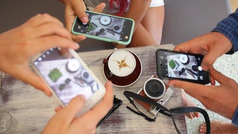 Hipster Hands Taking Pictures with Phone in Coffee Shop