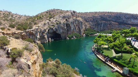 """Greece  Athens Aerial drone video of famous lake Vouliagmenis which means """"Sunken Lake"""" a rare geological formation, Athens Riviera, Attica, Greece"""