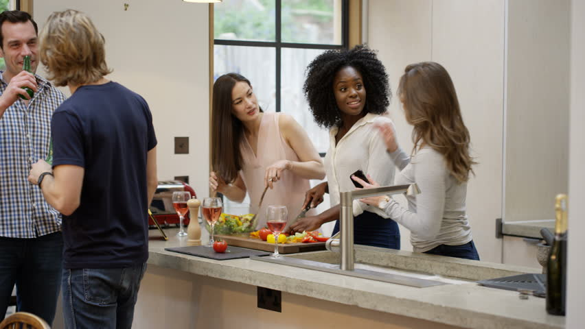 4k happy mixed ethnicity group of friends socializing at home 4k stock footage clip - Hosting A Party At Home