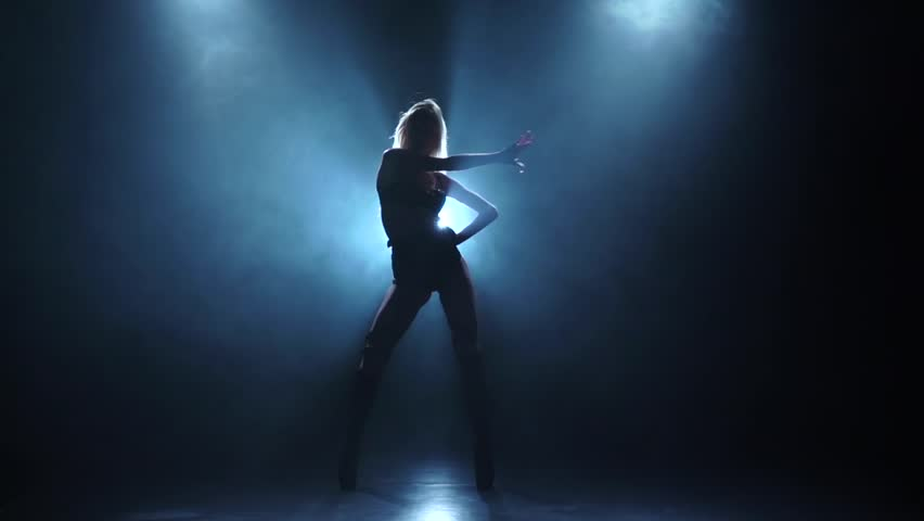 Sexy female pj is dancing in smoky studio, slow motion