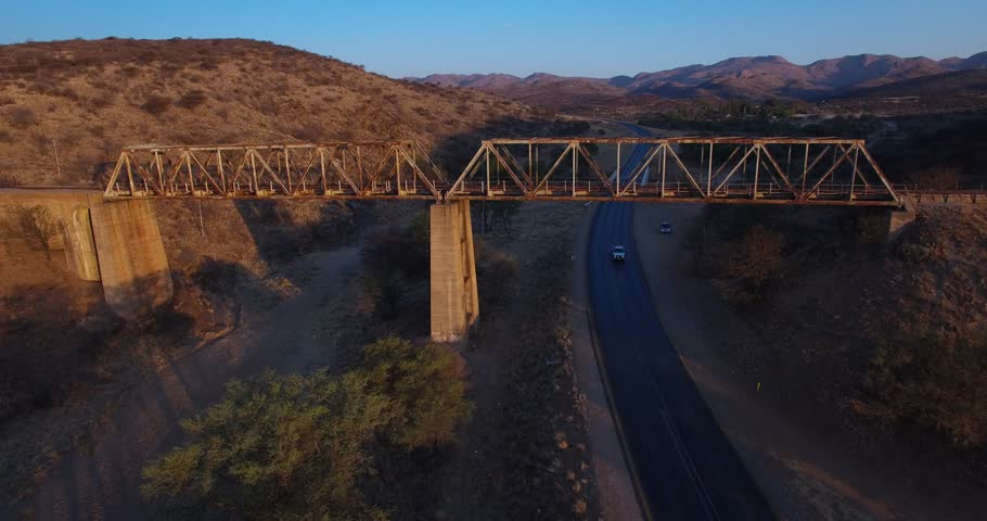 Aerial drone video with view of old railway bridge, set on main B6 road from Windhoek to Gobabis and Windhoek International Airport in central highland Khomas Hochland of Namibia, southern Africa | Shutterstock HD Video #25696451