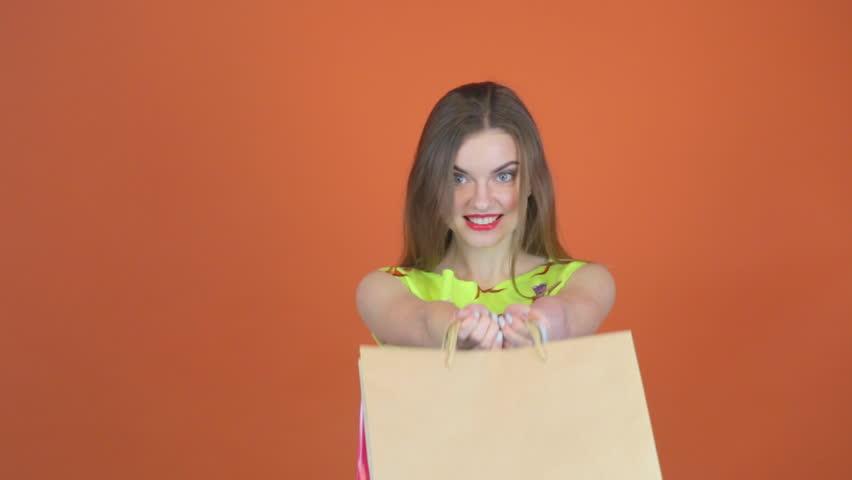Young woman standing keeps shoulders shopping bags   Shutterstock HD Video #25701854