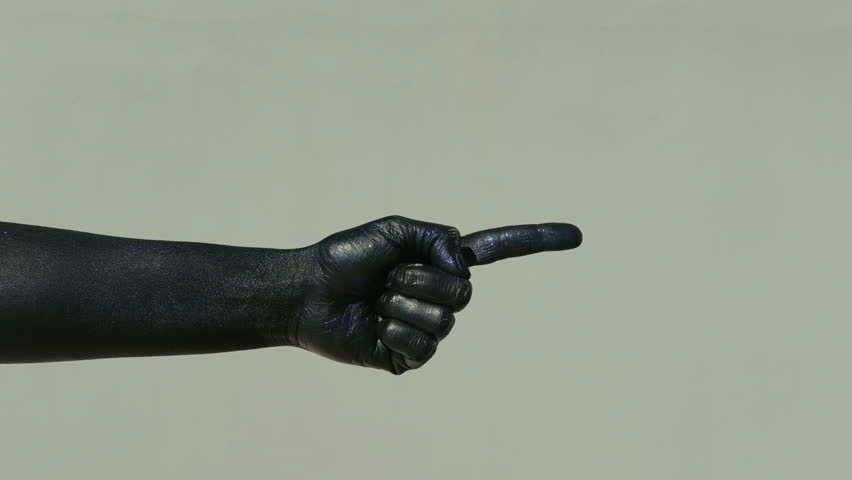 A black hand on a light wall shows a pantomime with an index finger. Finite man in a shiny soot indicates the direction of movement and rocking. A dark palm with a blue tint depicts a figure for the