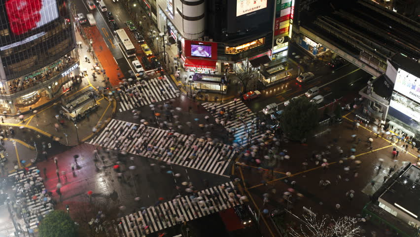 TOKYO, JAPAN - CIRCA MAY 2011: pedestrians and traffic across Shibuya Crossing,