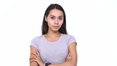 Beautiful young confused asian woman standing in hesitation and changing her mind on white background