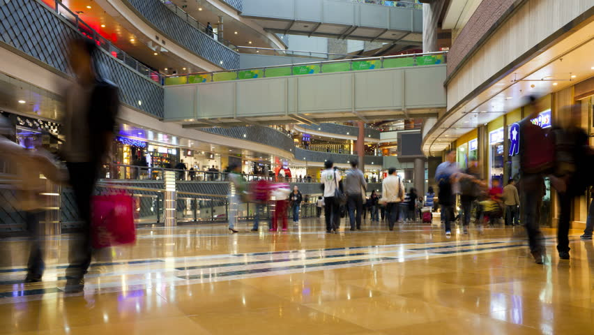 SHANGHAI, CHINA - CIRCA MAY 2011: shoppers inside a new modern shopping complex