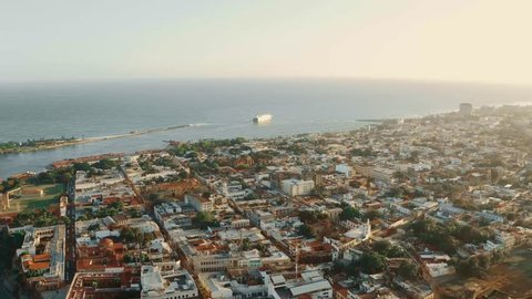 Amazing aerial view Monuments and squares of the Dominican Republic. City and Caribbean sea View from above. Drone view Santo Domingo city center. Coastline. The road along the sea. City by ocean