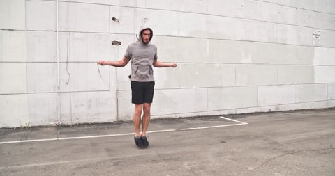 Athletic male working out in an empty parking lot. Crossfit. Slow Motion.