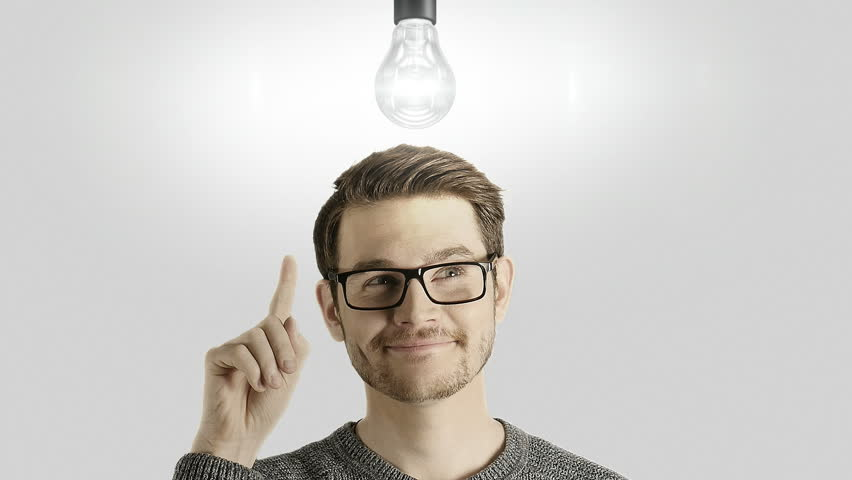 Clever creative man think gets an idea, which lights up a symbolic lamp over his head on white background | Shutterstock HD Video #25810931