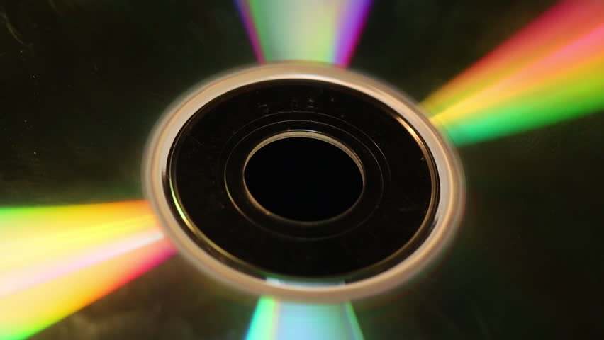 Compact Disc on Display, Every angle of light reflecting on a CD Macro spinning around with light hitting the surface