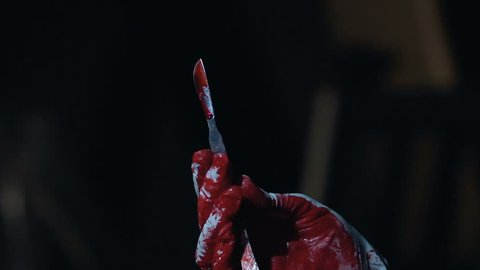 Bloody scalpel in hands of cruel maniac, person enjoying committed murder